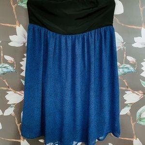 Strapless black and blue polka dot dress.